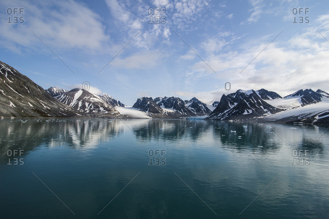 Mountains reflecting in the water in the Magdalenen Fjord, Svalbard, Norway