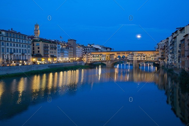 Ponte Vecchio bridge over the River Arno and full moon, Florence, Tuscany, Italy