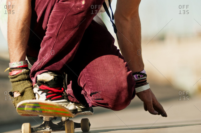 Ground level view of skater riding skateboard
