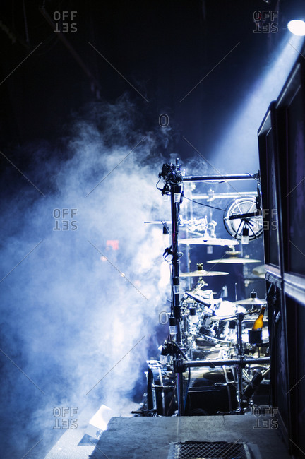 Concert stage set up with fog and lights