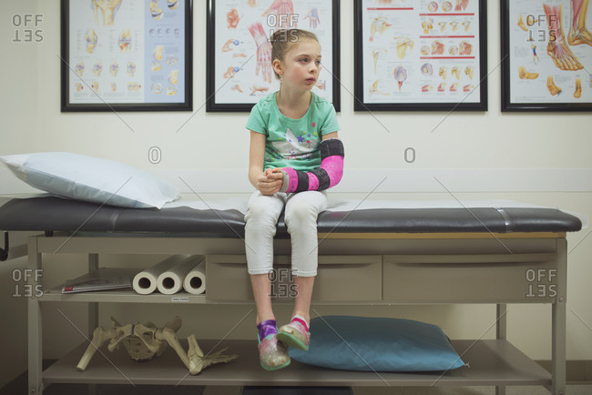 A girl with a broken arm at the doctor