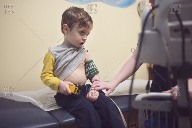 A little boy gets his blood pressure checked