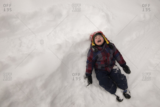 Young boy crying in the snow