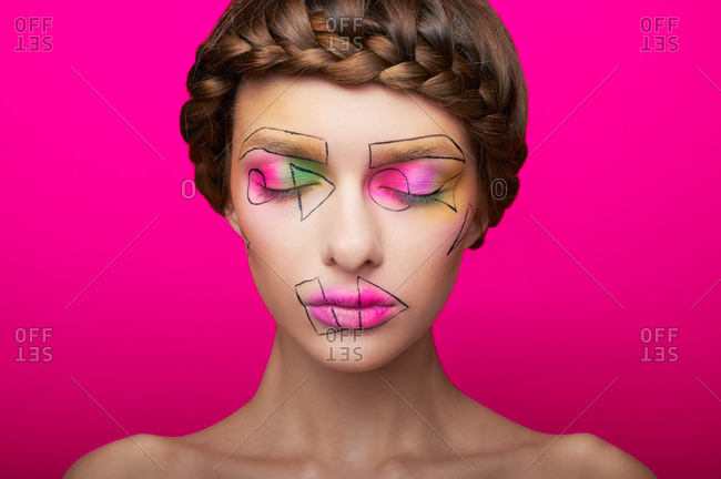 Portrait of a woman with cubism abstract make up