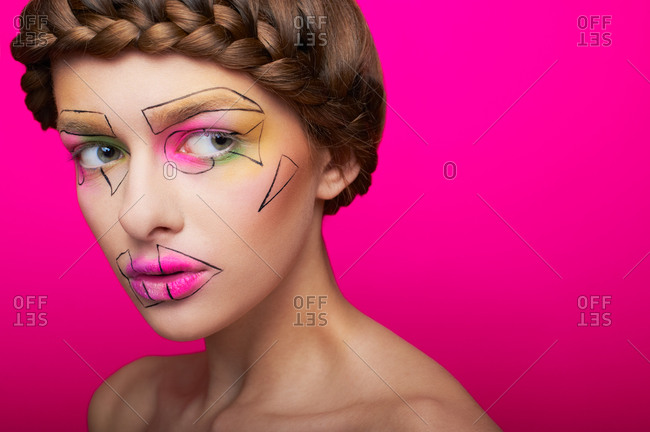 Studio shot of a woman with abstract make up on her face