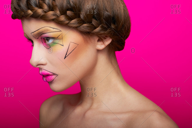 Profile of a woman with cubism abstract make up