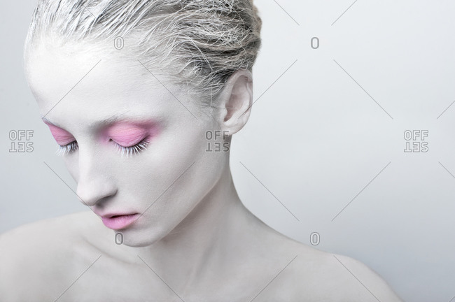 Studio shot of a woman with white painted face
