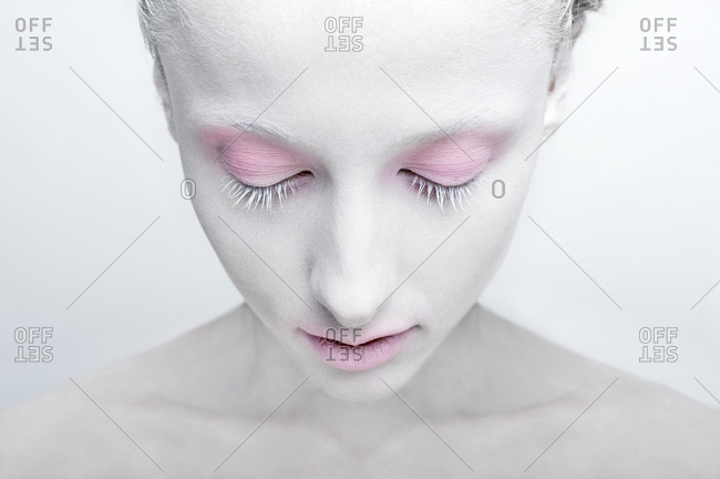 Studio shot of a woman with white face painting