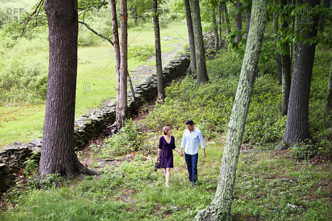 Mature couple talk while walking in the woods
