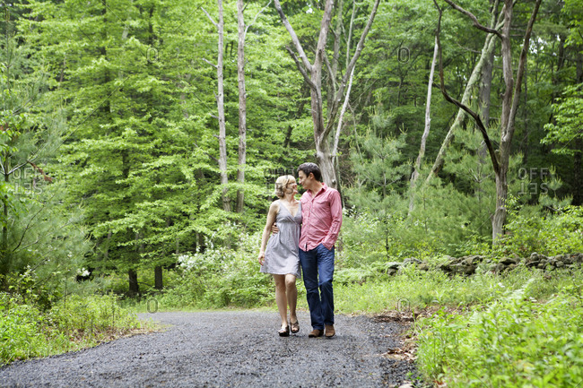 Romantic couple walking in the woods