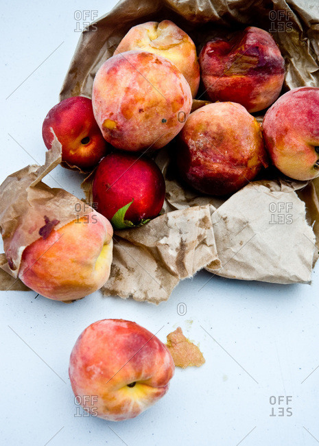 Bag of ripe peaches