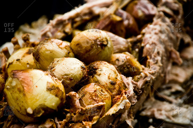 Whole pig roast stuffed with onions
