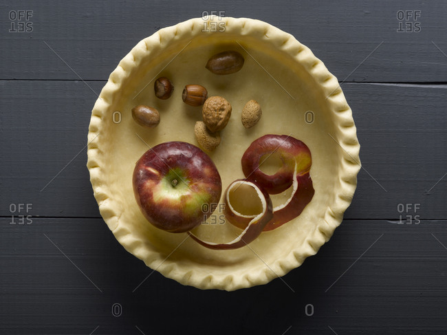 Nuts and an apple in a pie crust