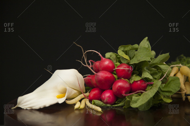 Root vegetables, beans and a calla lily