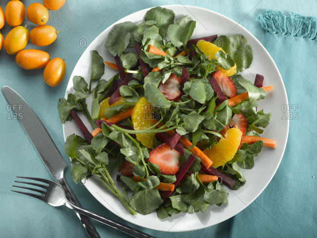 A leafy salad with fruit