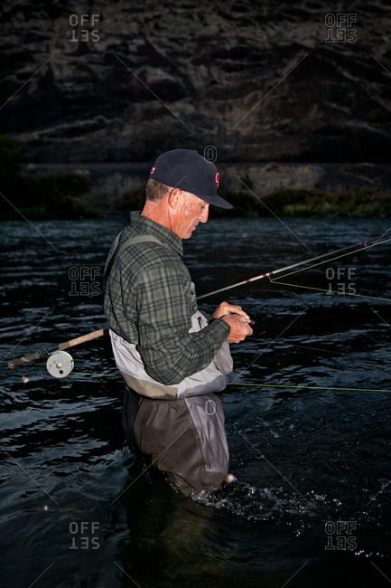 A man baits his fishing line