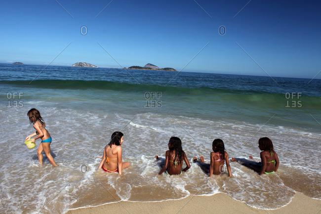 Rio De Janeiro, Brazil - July 11, 2010: Young girls relaxing on Ipanema beach