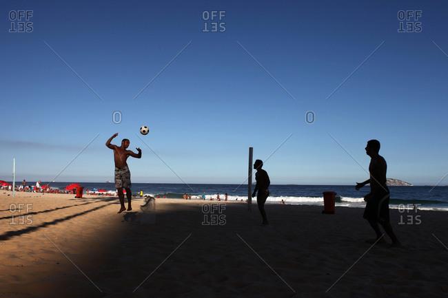 Rio De Janeiro, Brazil - July 23, 2010: People playing soccer on Ipanema beach
