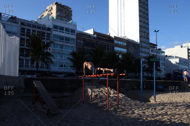 Man exercising on Ipanema beach
