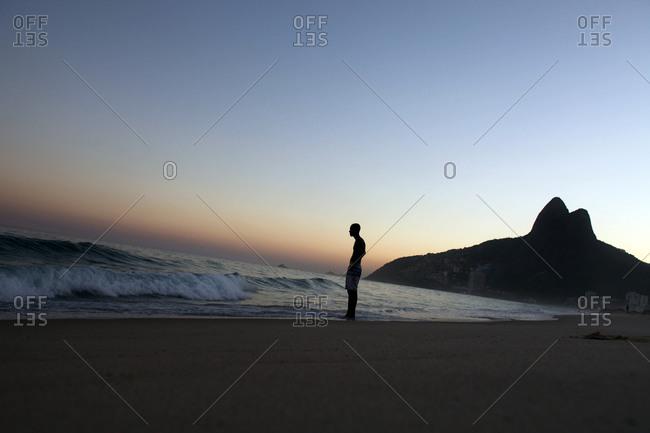 Rio De Janeiro, Brazil - August 3, 2010: Man standing at Ipanema beach