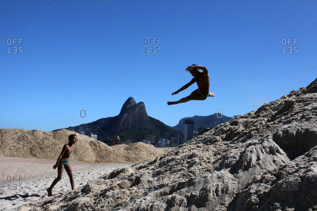 Rio De Janeiro, Brazil - August 3, 2010: Children playing on the sand dunes of Leblon beach