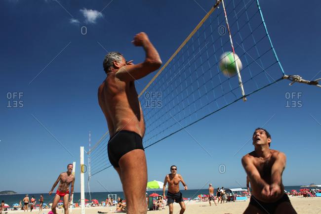 Rio De Janeiro, Brazil - July 31, 2010: Men playing beach volleyball at Ipanema beach