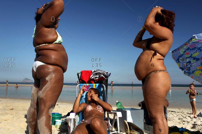 Rio De Janeiro, Brazil - July 9, 2010: Women relaxing on Sao Conrado beach