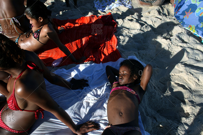 Rio De Janeiro, Brazil - July 9, 2010: People resting on Sao Conrado beach