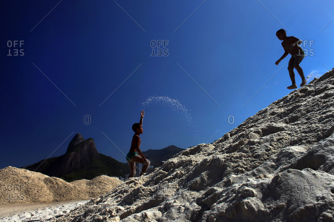 Rio De Janeiro, Brazil - July 10, 2010: Boys playing on the sand dunes of Leblon beach