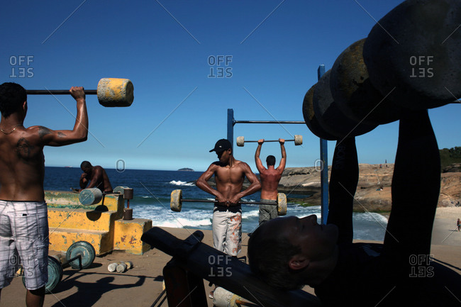 Rio De Janeiro, Brazil - July 11, 2010: Fitness enthusiasts work out at an outdoor gymnasium overlooking the ocean at Parque do Arpoador