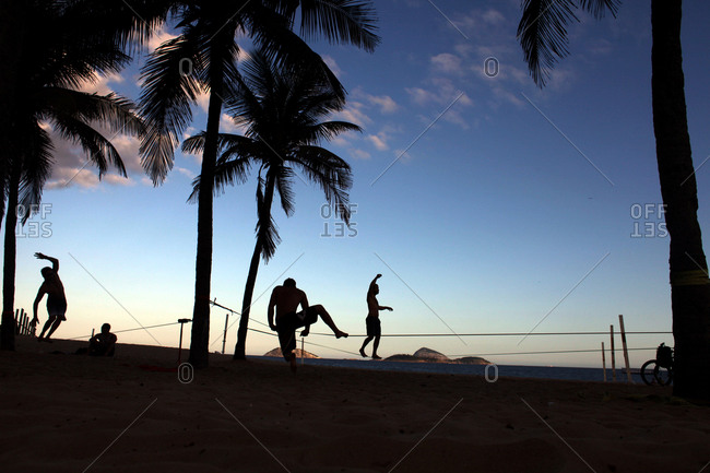 Rio De Janeiro, Brazil - July 11, 2010: Tightrope walkers practice at Ipanema beach
