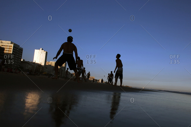 Rio De Janeiro, Brazil - July 9, 2010: Locals play soccer in the late afternoon on Ipanema beach