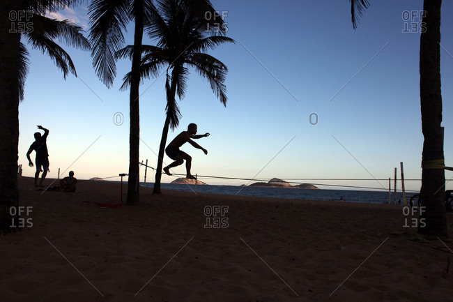 Rio De Janeiro, Brazil - July 13, 2010: Slackliners practice at Ipanema beach