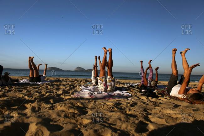 Rio De Janeiro, Brazil - July 15, 2010: An early morning fitness class on Ipanema Beach
