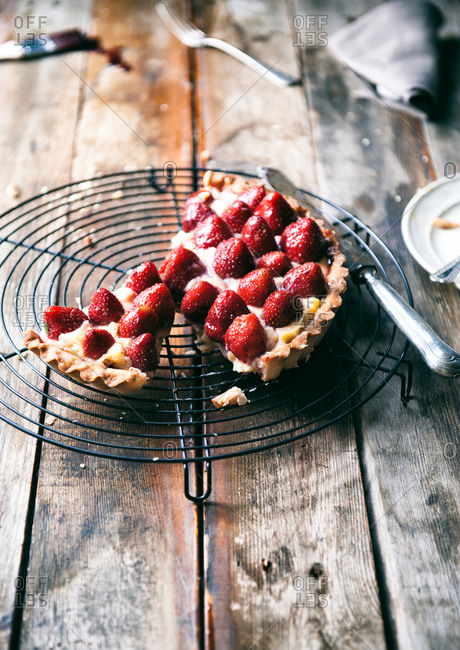 Strawberry tart on a cooling rack