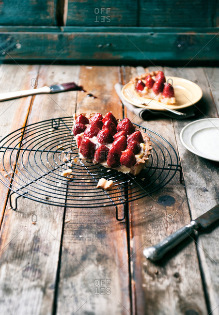 Piece of strawberry tart on a cooling rack