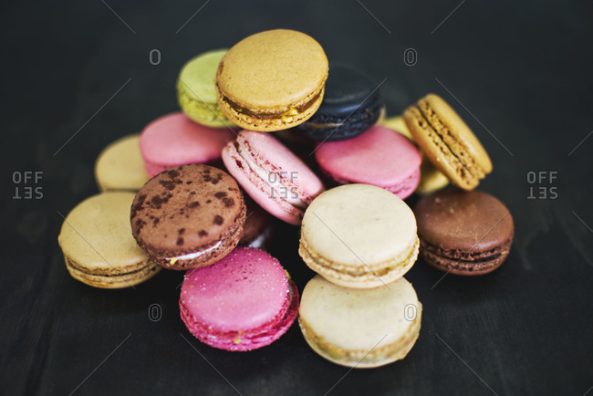 A pile of different flavored macarons