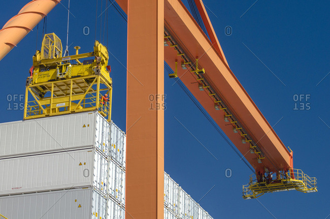 A worker unlocks containers to be unloaded by a gantry crane in Manzanillo, Mexico