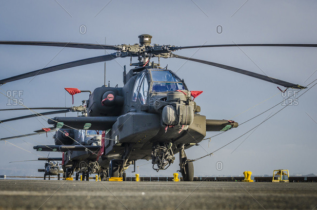Us Army Apache and Blackhawk helicopters tied down aboard a cargo ship in the Port of San Diego, California