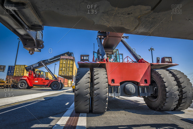 Reach stackers load containers at an intermodal railyard