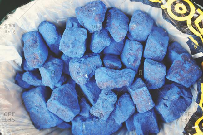 Lapis lazuli stones in a bowl
