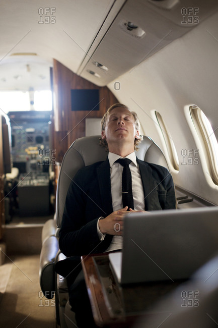 Businessman napping on his private jet