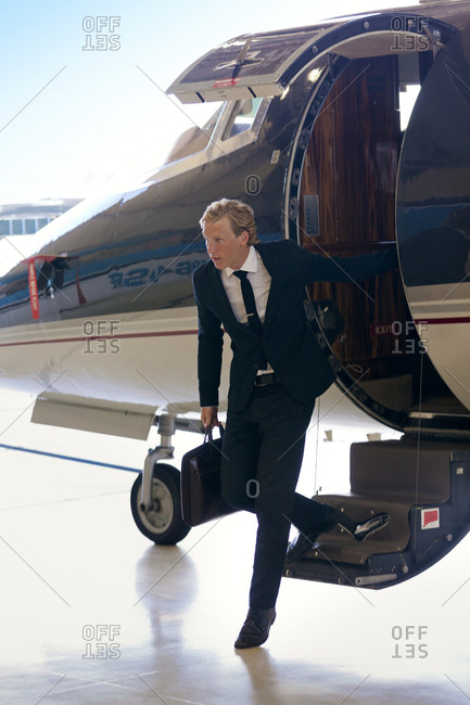 Businessman deplaning from a private jet