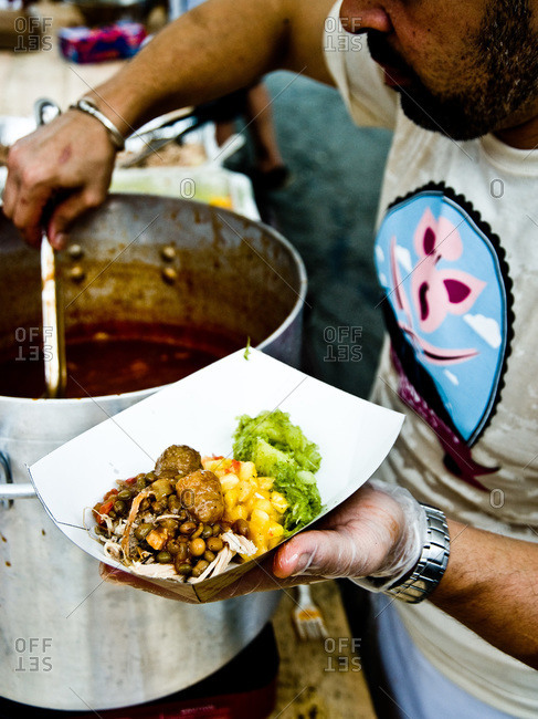 Narrowsburg, NY, USA - August 11, 2012: Man serving pulled pork at the Pig Mountain festival