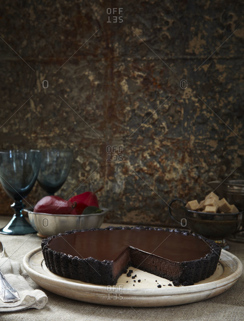 Decadent chocolate torte with piece removed