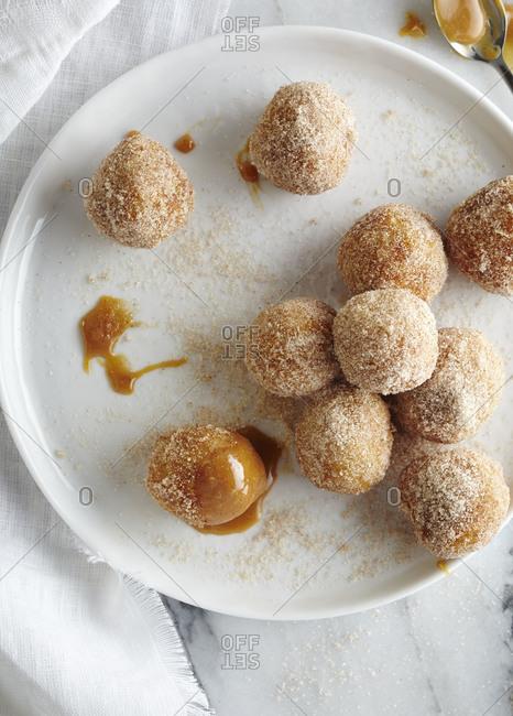 Churro balls with caramel sauce
