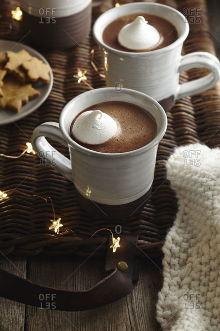 Hot cocoa with cream near cookies