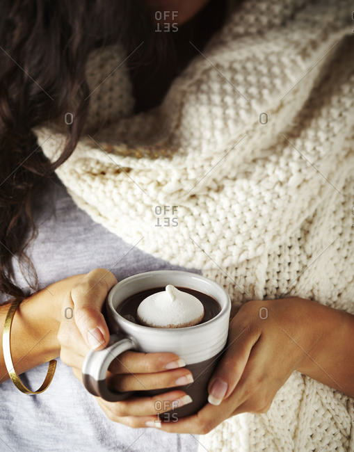 Woman holding delicious cup of hot chocolate