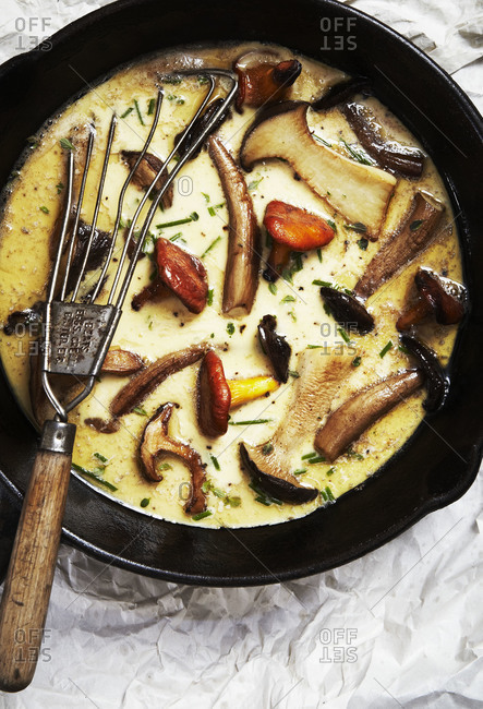 Mushrooms in frittata in cast iron pan