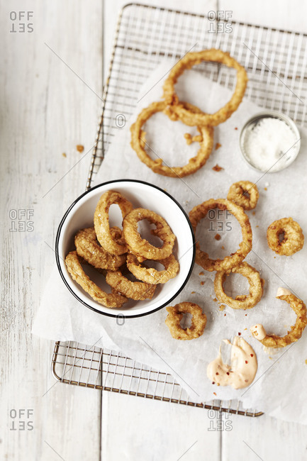 Onion rings cooling on rack